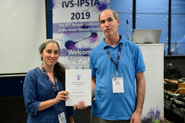 Meital receives the Award diploma. With Chairman of the plenary Prof Gilad Marcus from Hebrew University (from right)