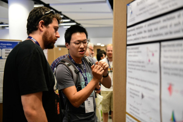 Postdoctoral Yan Cao explains the to interested listener the